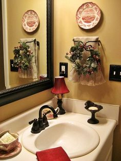 my french country guest bath, bathroom ideas, home decor, A mirror and fixtures in oil rubbed bronze continue the French country look I added a small wreath to the towel rack for a little bit of Christmas along with another plate