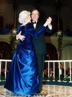 President George Bush and wife, Barbara - draped in a royal blue evening gown - dance on Jan. 20,1989 at the inaugural ball at the Pension Building in Washington.