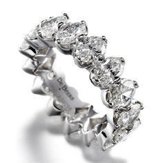 Round brilliant diamonds set in the De Beers exclusive Allegria setting allow maximum light to enter the stones.