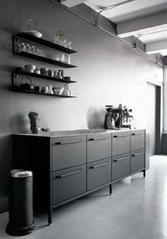 Those shelve made in rustic stained wood over stove would be awesome as a spice rack.