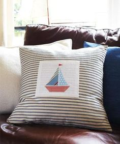 Sew a nautical applique cushion.