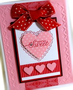 Sampin Up's Hearts a Flutter stamp set and coordinating framelit die, plus tulip border embossing folder and small heart punch...much to love here!