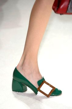 We're not mod at you Miu Miu. The brand for insouciant It girls is lowering heels and giving color-blocked shoes a graphic '60s flair.