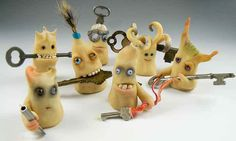 these are Christie Friesen polymer clay little ghoulies... they look like they had gotten out of a Gaiman book to me... mmm... keys... friends of Door?? ;)
