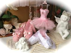 This listing for a set of a Miniature paper mache (top) pink ballerinas art dress. Dress is 5 tall without little hanger and 6 1/2 wide on the bottom of the skirt Skirt of the dress made from pretty sparkly tulle and the bodies i covered with pink fabric and decorated with beautiful trim,rhinestones and ribbon. Miniature dress hanger is included. Two pair of mini ballet shoes . Size 5 L covered with beautiful soft pink velvet fabric and decorated with ribbon and string pears. Size 4 1...