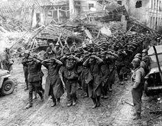 US MPs lead a column of German prisoners of war