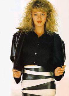Kylie in a Kim West zebra strip skirt and jacket in 19 Magazine
