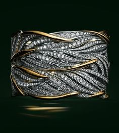 Beautiful Jewelry Flowing gold and platinum leaves twist around the wrist, accentuated with brilliant diamonds. - Browse The 2017 Blue Book Diamond Bracelets, Diamond Jewelry, Bangle Bracelets, Gold Jewelry, Bangles, Glass Jewelry, Bracelet Charms, Unique Bracelets, Diamond Brooch