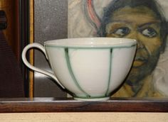 Handmade Stoneware Pottery Mug, Extra Large Mug, Soup Mug, Pottery Coffee Cup, Wheel Thrown Ceramic Mug, Delicate Mug in White and Green. Delicately painted extra large stoneware mug for coffee, tea, soup, salad, ice cream, etc. Unique Kitchen Art, Home Decor. Because of the weight of the handle during drying, the shape of the mug is not perfectly round. It might be a bit crooked. Pease see the last picture. Approximate measuring 5.5in/14.5cm wide (without the handle) by 3.4in/9cm high....