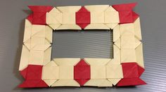 How to make your own origami Christmas modular frame using origami lover's knots! This decoration can be used as a Christmas ornament, a frame, place card ho...