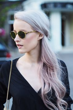 Cool gold rounded sunglasses from Etnia Barcelona with lilac and silver hair curls
