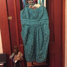 Teal leopard print semi-formal dress Adjustable straps, worn once !!! Has pockets which is always a plus ! BCX Dresses