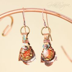 Polymer clay with resin and hand cut copper sheet metal. Earrings by Gaia Copia.