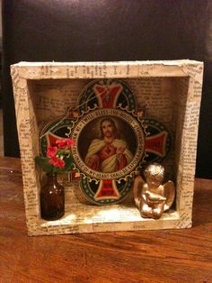 Simple wooden box shrine which has been collaged using pages from an old Christian book.