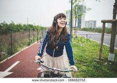 beautiful woman biker cycling in a desolate urban landscape - stock photo BUY IT FROM $1 ON SHUTTERSTOCK