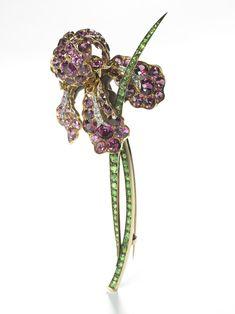 Iris Brooch, Tiffany & Co.  Pink tourmalines, demantoid garnet, platinum c.1900 –1901. Paulding Farnham, designer for Tiffany.