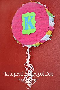 DIY pinata. No mess. No paper mache. Easy. You can then put anything you want on the front for your party theme. I may do a clown for our circus party. But clowns are creepy and scary so I will have to think it over.