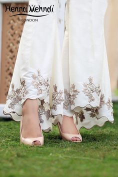 Best 12 Ivory raw silk flared trousers with embroidery and pearl embellishment. Can also be ordered in black colour. Please note delivery time is approximately weeks. There is no exchange or refund on this product as this item will be customised espec Salwar Designs, Kurti Designs Party Wear, Blouse Designs, Indian Designer Outfits, Indian Outfits, Moda Indiana, Indian Gowns Dresses, Designs For Dresses, Embroidery Suits