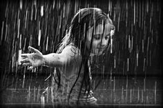 Little Girl Dancing in the Rain :)