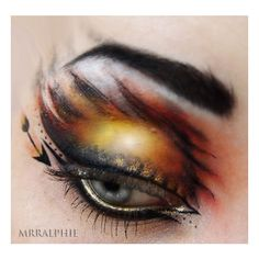 girl on fire makeup.....@Anikka Lekven I really want to show you this but I'm afraid you'll spaz out some more and I worry about your blood pressure levels when you see Hunger Games related things....
