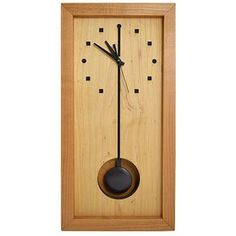 Cherry + Maple Wood Tall Box Clock. Handcrafted with traditional joinery techniques, the clock consists of natural kiln-dried woods native to the Appalachian mountains that are certified sustainable. A thick frame of distinctive wild cherry wood surrounds a clock-face of hard natural maple, while die-cut lines and numeral markings provide a lively, contemporary style. Each clock includes a meticulously hand-rubbed finish of beeswax/mineral oil to protect the natural look of the wood.