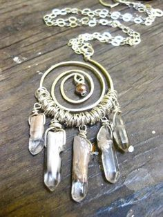 DIY dream catcher...this would be a cool necklace...