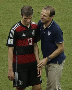 United States' head coach Juergen Klinsmann, right, greets Germany's Thomas Mueller after Germany beat the United States 1-0 during the group G World Cup soccer match between the USA and Germany at the Arena Pernambuco in Recife, Brazil, Thursday, June 26, 2014. (AP Photo/Hassan Ammar)