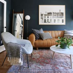 A perfect place to sit and watch the world go by. The Savary chair features low arm rests, a generous seat, cushy foam padding, and contemporary powder-coated metal legs. Photo by Sunny Circle Studio. Navy Living Rooms, Accent Walls In Living Room, Living Room Color Schemes, Living Room Green, Living Room Designs, Living Room Decor, Dark Blue Bedroom Walls, Navy Blue Walls, Dark Gray Walls