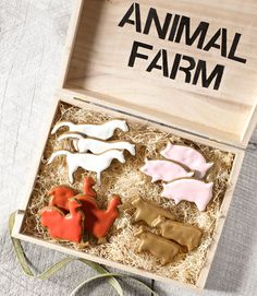 "Traditional gingerbread takes a walk on the wild side, via animal cookie cutters. Corral the whole stable in a hand-stenciled box filled with ""hay."""