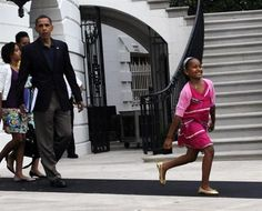 U.S. President Barack Obama (3rd L), First Lady Michelle Obama (obscured), and their daughters Malia (L) and Sasha walk out of the White House in Washington toward Marine One on the South Lawn to depart for Russia on July 5, 2009. President Obama...