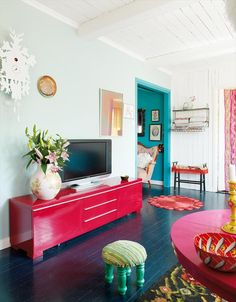 I like the red credenza. And the way the teal doorway leads into the teal room.
