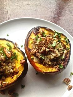 Stuffed Acorn Squash  with beef, and cauliflower rice and topped with pecans.
