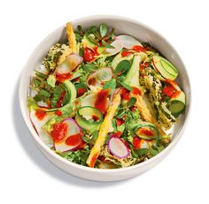 This combo of raw, steamed and fried vegetables is a crunchy canvas for chile-jam dressing laced with fish sauce and lime. Click on the link for the complete recipe. (Photo: Ian Allen for The New York Times)