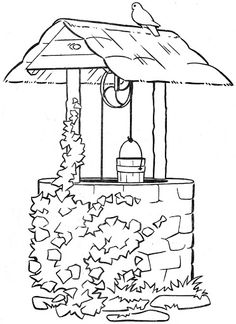 Vintage hand-dug water well with hand crank and water