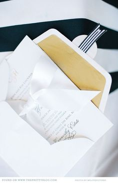 White & gold wedding stationery   Photo: welovepictures, Stationery: Seven Swans