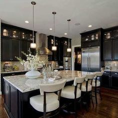 -- dark cabinets and dark flooring