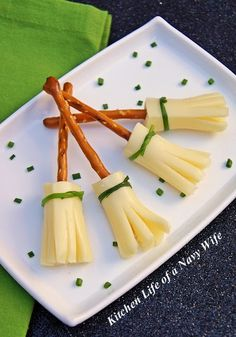 Halloween Witches Broom Sticks ~ fun and easy... made with string cheese & pretzel sticks.  Great healthy treat!
