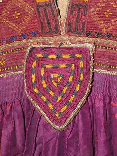 Detail of embroidered purple tunic, Pashtun culture, Afghanistan, ca. 1900-25, KSUM 1983.1.884.