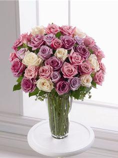 Three dozen Pastel roses in a glass vase