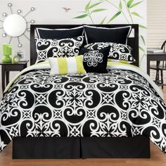 Add contemporary style to your bedroom with this striking black and white reversible comforter set. This polyester set is machine washable for easy care. It has a black and white classic print on one side and bold lime and white stripes on the other.