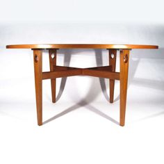 Hans Wegner Table | From a unique collection of antique and modern dining room tables at http://www.1stdibs.com/furniture/tables/dining-room-tables/. I like the cutouts and metal detailing.