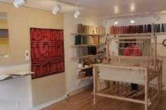 Mary Kasala weaves in her gallery, Kasala Gallery in Crested Butte, CO. Tapestry by Rebecca Mezoff, Emergence I