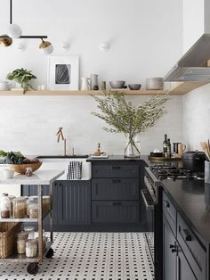 Homebody: A Guide to Creating Spaces You Never Want to Leave by Joanna Gaines . Dark kitchen and tile Painting Kitchen Cabinets, Kitchen Cupboards, New Kitchen, Minimal Kitchen, Interior Design Kitchen, Kitchen Designs, Dark Kitchen Countertops, Charcoal Kitchen, Mexican Style Kitchens