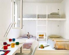 Three beds in a room.
