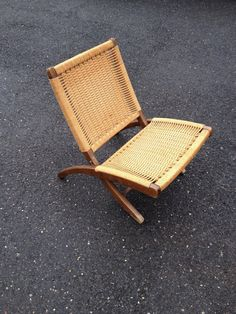 Mid Century Hans Wegner Style Folding Rope Chair Great vintage condition, there is some finish wear at bottom of legs Make in Yugoslavia,