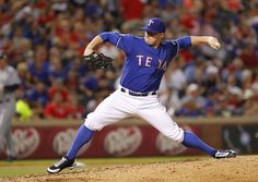 ARLINGTON, TX - MAY 29: Robbie Ross #46 of the Texas Rangers delivers a pitch against the Seattle Mariners at Rangers Ballpark in Arlington on May 29, 2012 in Arlington, Texas. (Photo by Rick Yeatts/Getty Images) game 50