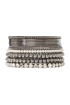 Hematite beads, pearls and rhinestones accent this pack of hematite bangles. Mix and match for a sophisticated and stylish look.