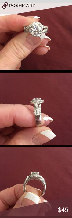 🌺Sterling Silver CZ Ring Stunning 2.5 carat high quality AAAA CZ encircled with .8 size czs in 925 silver Halo setting. Size 7. This ring is so beautiful, everyone thinks it's real! Brilliant sparkle, no rainbow effect. Selling because it is too small for me now. Gently worn, mint condition! Jewelry Rings