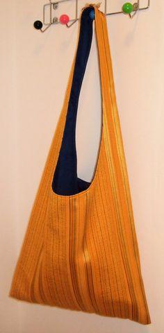 Handmade retro slouch bag using original 1970's fabric.