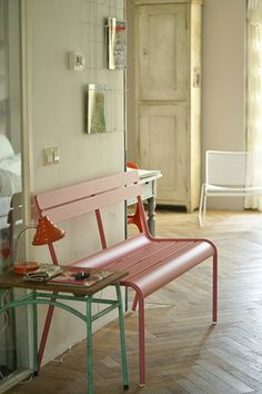 A simple metal vintage bench painted pink ~~~~ perfect.